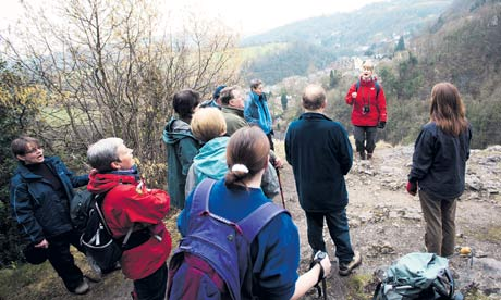 Candy Verney leads a group of singers on a hill in the Peak District