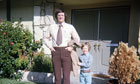 Father and son in front of house, dressed for church