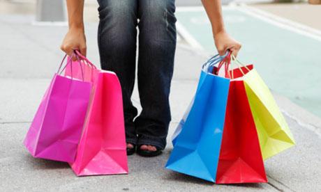 Woman picking up shopping bags