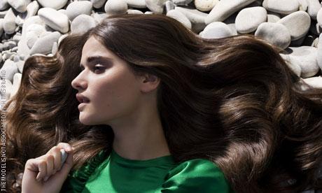 Female model on some pebbles