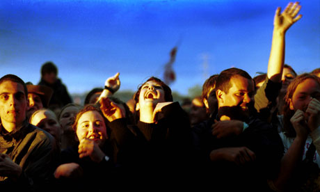 A crowd of teenagers watching a band at the Glastonbury Festival, June 2000