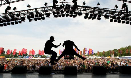 An air guitarist performs on stage