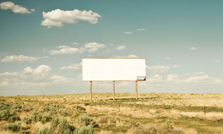 Blank billboard in deserted country setting