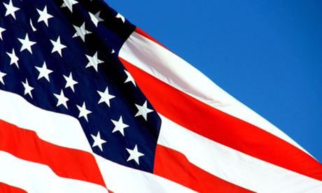 United States of America flag waving against blue sky
