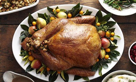 John Lewis: Turkey, stuffing, and gravy dishes on wood surface