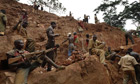 Men digging for gold in a pit in the Ituri Forest
