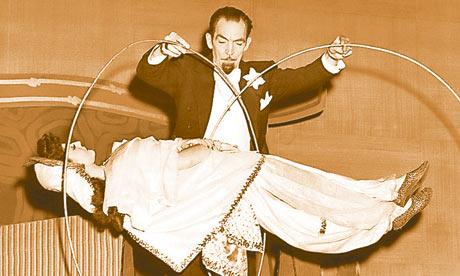 Magician performing levitating trcik