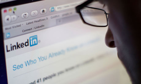 Man in glasses looking at the Linkedin website