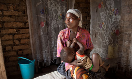 A mother nurses a young child in Masaka, Uganda, East Africa.