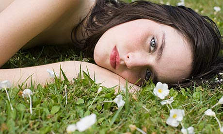 Aveda: Young woman lying on grass