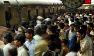 Commuters board a train at a railway station in Mumbai. Photograph: Reuters