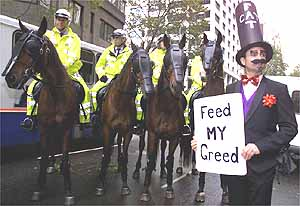 A May Day anti-globalisation protester stands in front of mounted police during a demonstration outside the Australian stock exchange in Sydney. A few thousand protesters blocked key financial streets in the centre of the city, with many scuffles breaking out between protesters and police.
