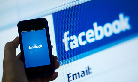 Facebook on screen and mobile