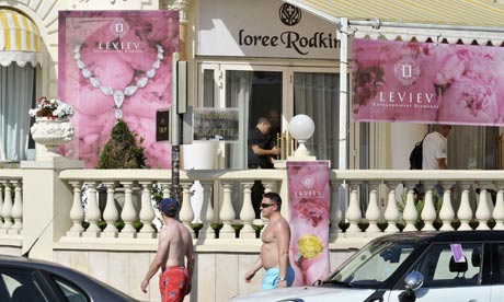 Police examine the crime scene at the Carlton Cannes jewellery