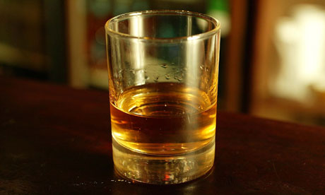 Glass of whisky on a bar
