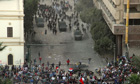 Riot police and protesters clash in Tahrir square