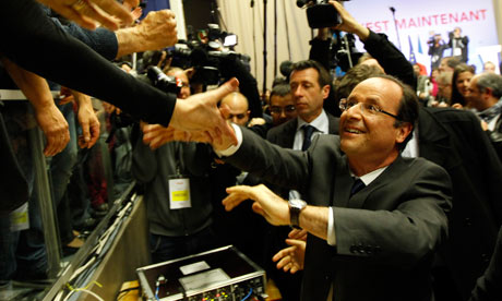 François Hollande greets supporters during the first round of the French presidential elections