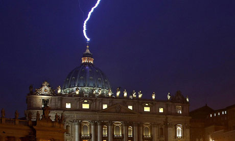 A lightning strikes the basilica of St Peter's dome