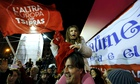 supporters of leftist Syriza party Tsipras cheer at exit poll results in Athens