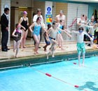 Children jump into the pool at Bramley Baths in Leeds