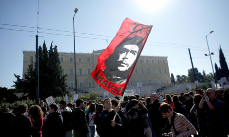 People demonstrate in front of the Greek parliament in Athens