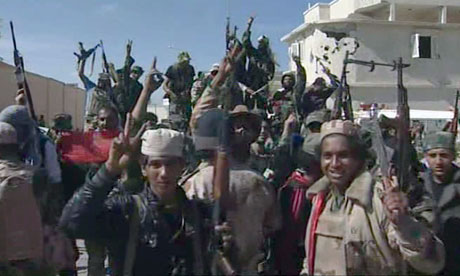 Libyan fighters celebrate in the streets of Sirte, Libya