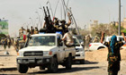 Anti-Gaddafi fighters celebrate the fall of Sirte, Libya