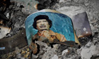 A picture of Gaddafi in the ashes in downtown Sirte, Libya