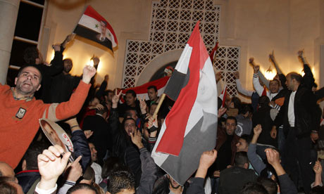 Syrians protest outside the Qatari Embassy in Damascus