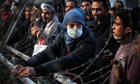 A woman protester attempts to dismantle a barbed wire barricade near Tahrir square in Cairo, Egypt