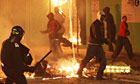 Riots: Riot police patrol the streets in Tottenham, north London as trouble flared