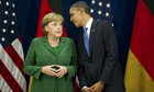 US President Barack Obama talks with German Chancellor Angela Merkel ahead of G20 Summit