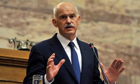 Greek Prime Minister George Papandreou gestures as he addresses the socialist party group