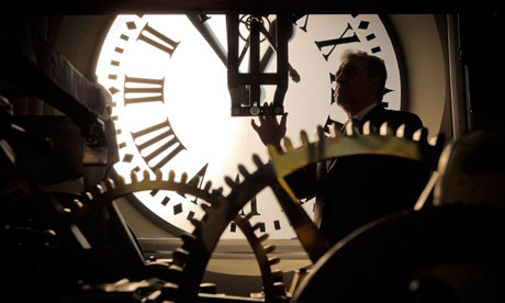 A clockmaker checks and adjusts the Madrid New Year clock