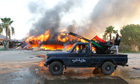 Libyan rebels celebrate at Bab al-Aziziya compound in Tripoli, Libya