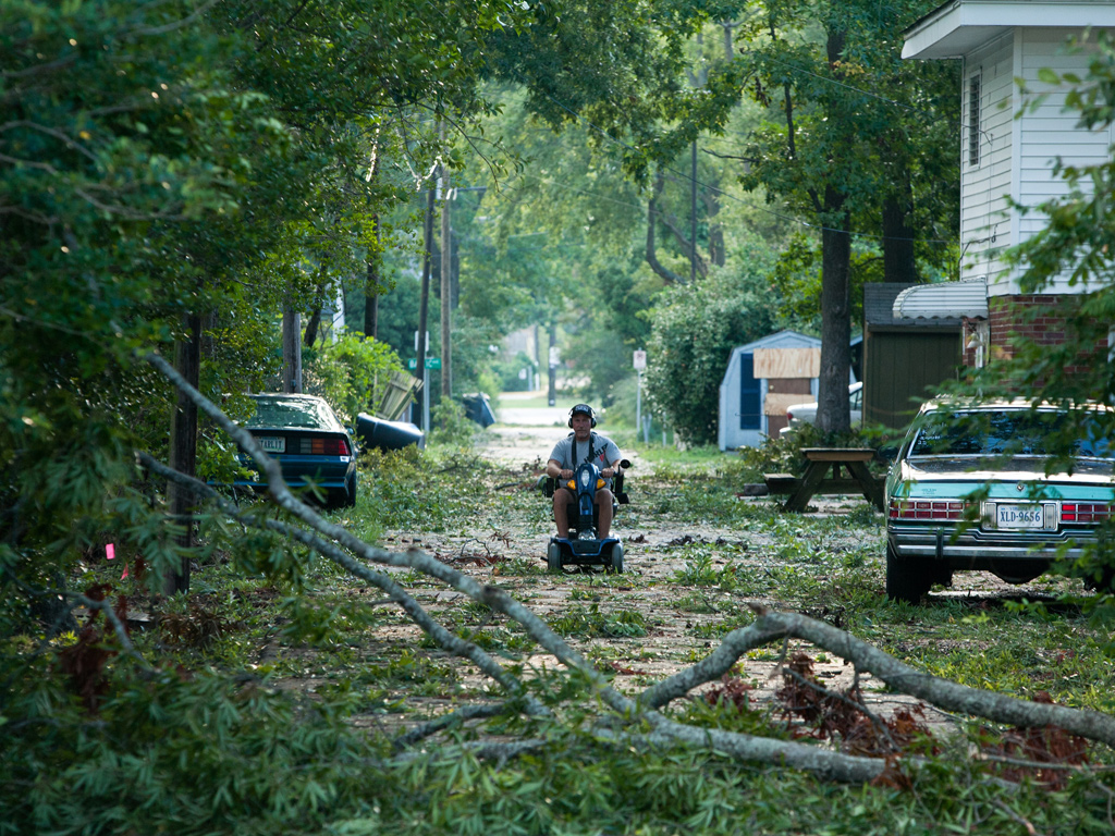 Virginia Beach, Virginia: Branches brought down by Hurricane Irene litter a road