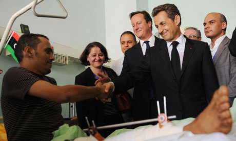 Prime Minister David Cameron and Nicholas Sarkozy meet patients at Tripoli Medical Centre in Libya