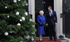 Queen Elizabeth II is welcomed by Prime Minister David Cameron outside 10 Downing Street
