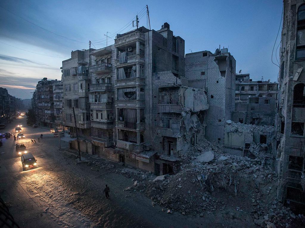 Night falls on a rebel-held area in Aleppo