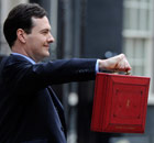 Chancellor of the Exchequer George Osborne holds aloft his red despatch box