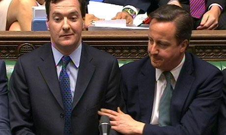 David Cameron pats the arm of the Chancellor after he delivered his Budget