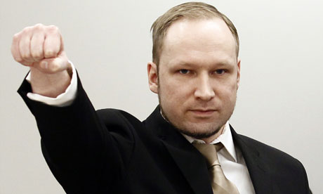 Anders Behring Breivik makes a far-right salute as he enters the Oslo district courtroom