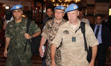 UN observers leave the Sheraton Hotel in Damascus, Syria