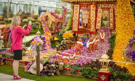 A visitor photographs the Thai exhibit in the Great Pavilion, at the RHS Chelsea Flower Show