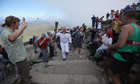 Sir Chris Bonington carries the Olympic torch as he approaches the summit of  Mount Snowdon