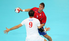 A Croatian player attempts a tackle