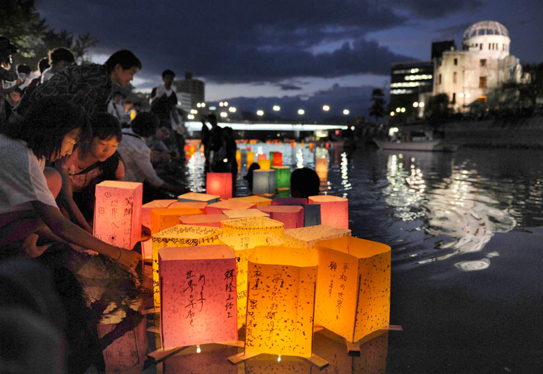 People release paper lanterns on Motoyasu river on the 67th anniversary of bombing of Hiroshima