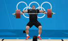 Behdad Salimikordasiabi from Iran wins gold in the weightlifting