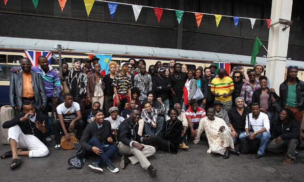 The Africa Express: musicians of African and Western Collective pose by a train