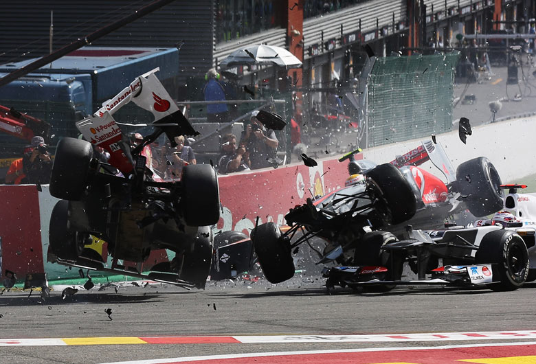 Fernando Alonso, left, and Lewis Hamilton collide at the Belgian Grand Prix